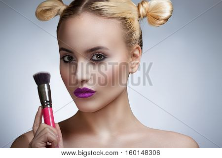 Portrait Of The Girl With A Bright Make-up Professional. A Girl Holding A Brush.