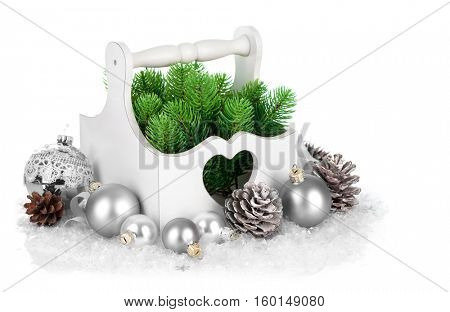 Christmas firtree with silver ballss and pinecone. Isolated on white background