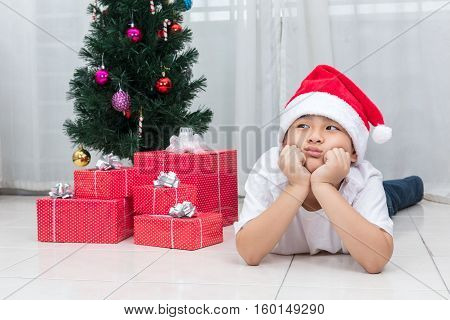 Asian Chinese Little Boy Showing Bored Expression With Christmas Presents