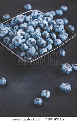 Blueberry on black background. Top view flat lay