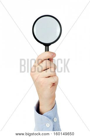 Man's hand holding magnifying glass