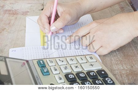 hand accounting passbook bank and payment slip for financial expense and income
