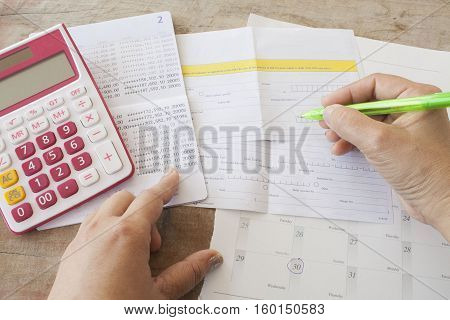 hand accounting passbook bank and payment slip for financial expenses and income