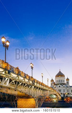Moscow Christ the Savior against the blue sky. Pedestrian Patriarchal bridge