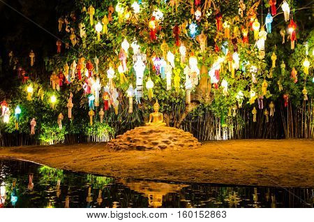 Buddhist monks sit meditating under a Bodhi Tree at the Wat Pan Tao temple November, 2015 in Chiang mai, Thailand