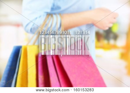 Barcode on blurred shopping bags background. Wholesale and retail concept.