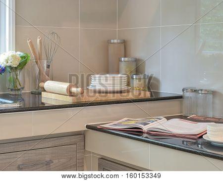 Bakeware Set On The Black Granite Top In Modern Kitchen