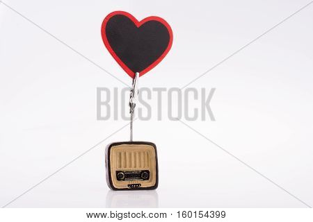 Retro syled tiny television radio and typewriter model on a white background