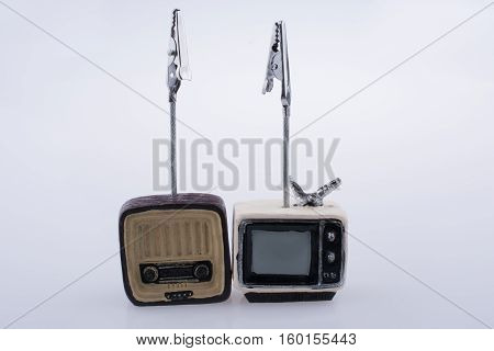 Retro Syled Tiny Television And Radio Model On White Background