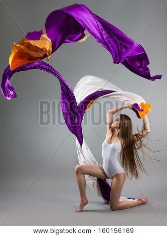 Beautiful Young Girl Dancing. Flowing Fabric.