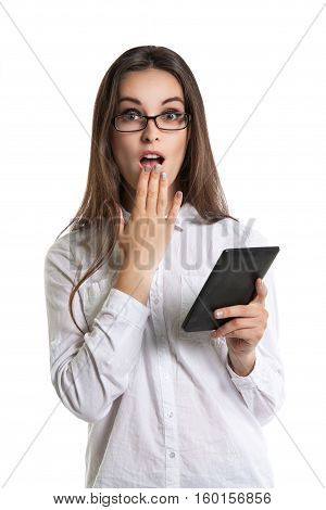 Beautiful Young Long-haired Woman In Glasses With An E-book. Human Emotions, Surprise, Mouth Open