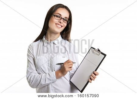 Joyful Beautiful Woman With A Clipboard In His Hands. Long-haired Brunette In Glasses And A White Sh