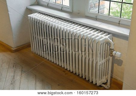 Old heating radiator by the window