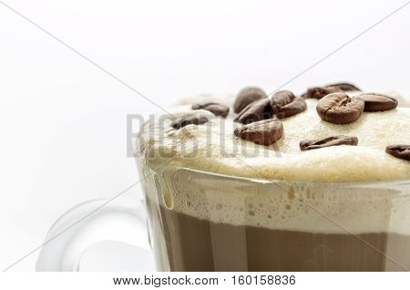 Capuccino In Glass Cup Isolated On White. Close-up