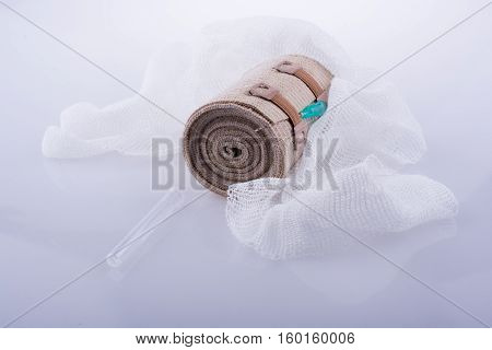 Absorbent Gauze, Bandage, And Injection Placed On  White Background