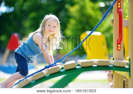 Cute Little Girl Having Fun On A Playground