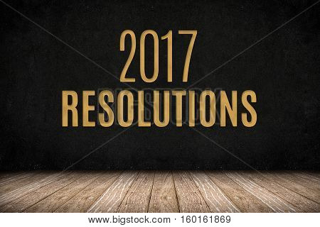 2017 resolutions gold text on blackboard wall on wood plank floorNew year business planing,3d rendering