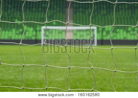 Beach soccer football goal through the net. Games in Brazil.