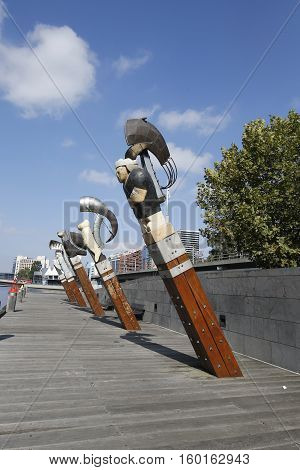 MELBOURNE, AUSTRALIA - JANUARY 25, 2016: Constellation sculptures by Bruce Armstrong and Geoffrey Bartlet in Melbourne. The five carved-wood figureheads comprise a dragon, woman, bird, man and lion.