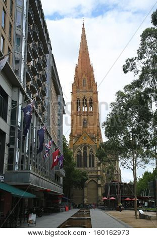 MELBOURNE, AUSTRALIA - JANUARY 24, 2016: St. Paul's Cathedral in Downtown Melbourne. View from City Square. The cathedral was built in stages and is one of the City of Melbourne's major landmarks