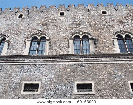 Front of medieval italian building in ancient city of TAORMINA in SICILY, ITALY with clear blue sky in warm and sunny spring day, EUROPE on MAY.