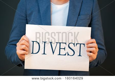 Divestment concept with businesswoman in suite - finance and economics business theme.