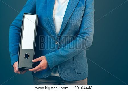 Business company accountant holding document binder with archived paperwork and other corporate legal sheets mock up copy space