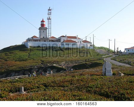 Lighthouse and beauty natural scenery of CABO DA ROCA (CAPE ROCA) coast in PORTUGAL with clear blue sky in cold autumn day, EUROPE on OCTOBER.