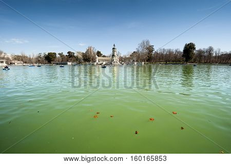 Lake in Retiro Park, Madrid, Spain. At the background the Monument to King Alfonso XII.