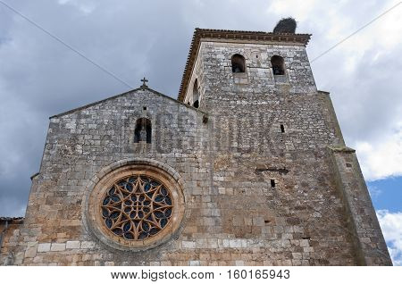 San Cosme and San Damian Collegiate Church, Covarrubias, Burgos, Spain. It was built based on an earlier Romanesque church. It is a 15th century Gothic church. It has a Latin cross floor plan three naves and a crossing