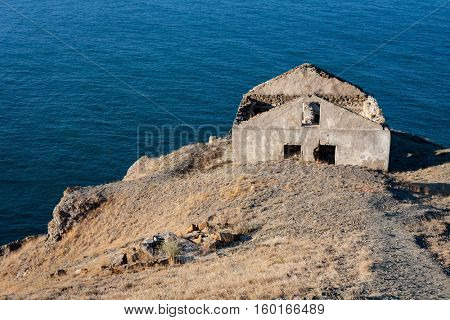 ods abandoned ruined house over sea
