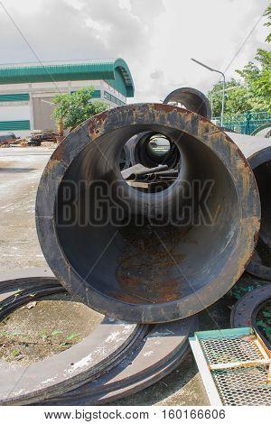 Iron scrap of metal pipeline in factory.