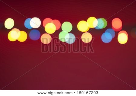 Bokeh lights background. Abstract multicolored light. Blur spot light. Defocus colorful light. Colorful blur light background. Defocused light. Bokeh light texture. Christmas blur light on red background. Light abstract. Circle multicolored blur light.
