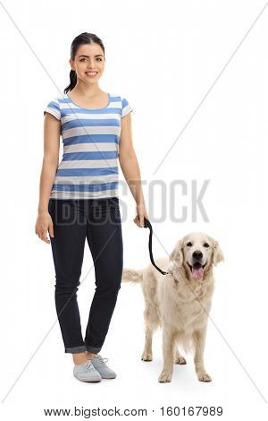 Full length portrait of a young woman with a dog isolated on white background