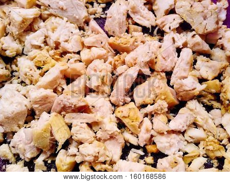 Chopped cooked chicken with some seasoning like salt, pepper, etc