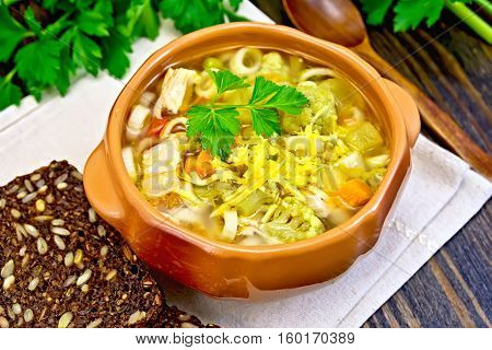 Soup Minestrone In Clay Bowl On Board