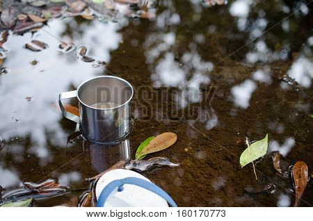 Place in a glass of hot coffee and cold clear streams. White sandals relaxing waterfront.
