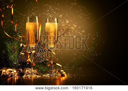 champagne glass decorated with festive christmas elememnts