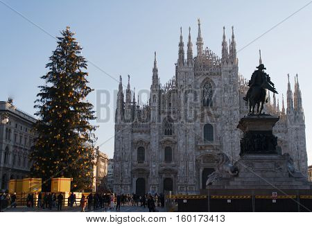 Winter daytime view of famous Milan Cathedral (Duomo di Milano) on piazza in Milan Italy on December 30, 2013