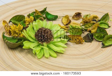 Green aromatic dried herbs aromatic flowers on wooden background.
