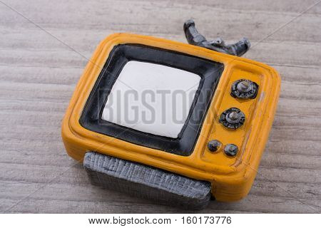 Retro Syled Tiny Television Model On Grey Background