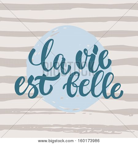 la vie est belle - hand drawn French lettering phrase it means Life is beautiful isolated on striped grunge background. Fun brush ink inscription for greeting card or t-shirt print, poster design.