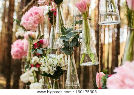 Wedding flowers decoration arch in the forest. The idea of a wedding flower decoration. wedding concept in nature.