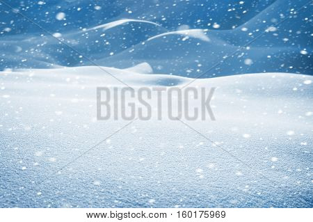Winter snowy landscape with snowdrifts and snowstorm