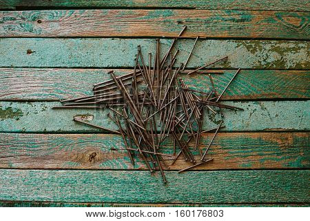 Nails on a wooden surface. Joinery tradition. Construction concept.