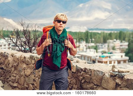 Backpacker tourist arrive in mountain tibetan settlement