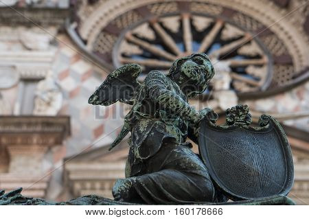 Angel with a shield as a decorative element fence Colleoni Chapel. Bergamo. Italy