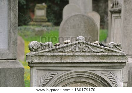 The old Jewish cemetery in Prague, Czech Republic. Ancient gravestone with decorative elements close up.