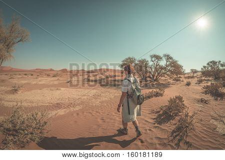 Tourist Walking In The Majestic Namib Desert, Sossusvlei, Namib Naukluft National Park, Travel Desti