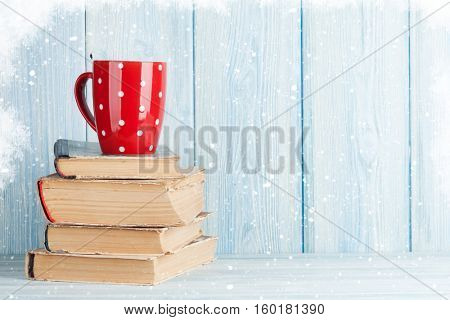 Hot chocolate cup on books. Christmas. View with copy space